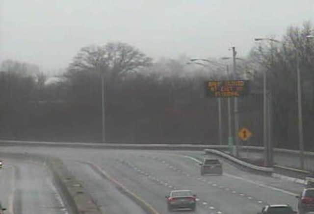 A sign on I-95 in Stratford warns of a closed exit ramp as heavy rain falls across the area.