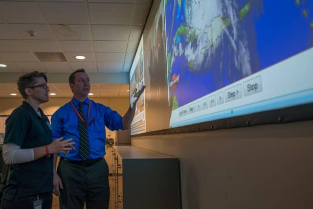 State officials look over a map of the path of Hurricane Joaquin last week.