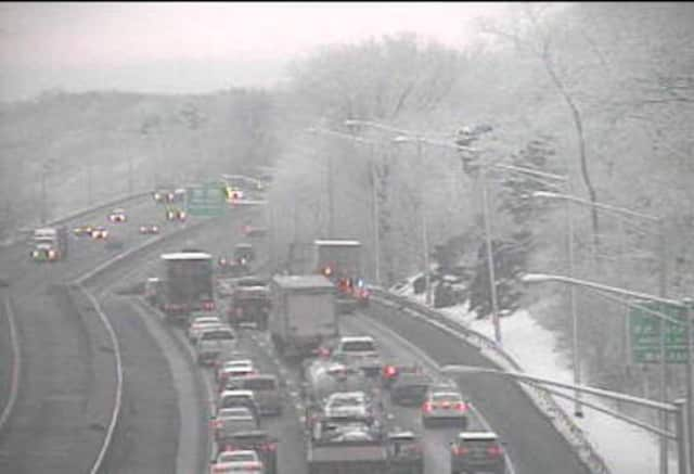 Traffic on I-95 south in Westport is slow due to a tractor-trailer fire on a snowy Monday morning.