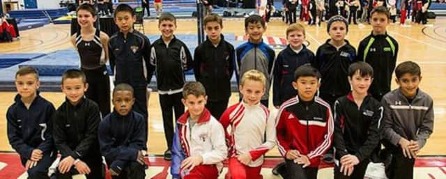 Eli Osuna, pictured third from left in the top row, poses for a photo with the 10-year-old Junior National Team.