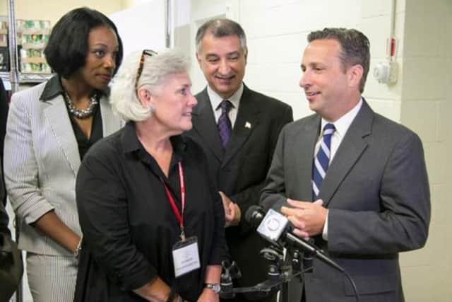 State Senate Majority Leader Bob Duff, right; state Sen. Carlo Leone, middle; Ceci Maher, P2P's executive director; and Rebecca Wilson, far left, P2P board president, celebrate the new state grant.