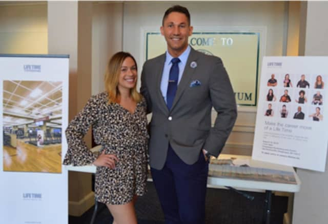 Jennifer Duran, sales manager, and Mike Spiegel, general manager, at a Life Time Athletic Chappaqua hiring fair on Aug. 18. Another hiring fair for about 200 jobs is planned on Saturday, Sept. 8.