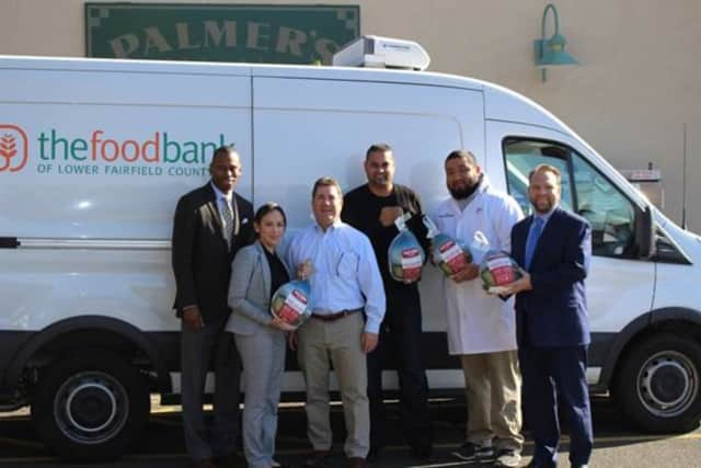 First County Bank and Palmer's Market recently donated 100 turkeys to the Food Bank of Lower Fairfield County.