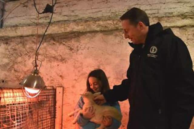 Westchester County Executive Rob Astorino, right, with a baby pygmy goat at Muscoot Farm in Somers.