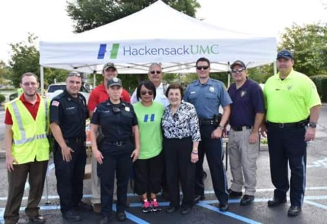 Police officers, AAA and HUMC officials partnered for a CarFit program in Woodcliff Lake.