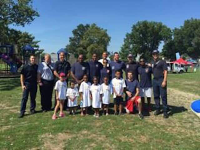 Members of the Stamford Professional Fire Fighters Association got together with city youngsters recently on the tennis courts. The get-to-know-you games took place at Family Fun Day in Cummings Park.