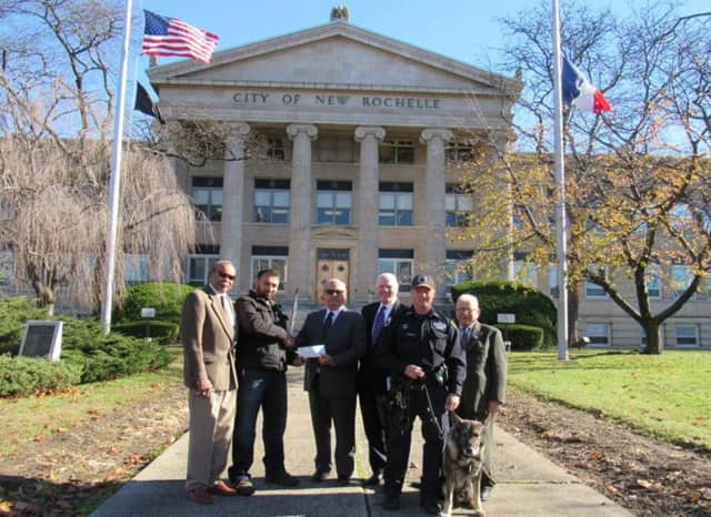 Members of the New Rochelle Police Foundation with Ramiro Lopez.
