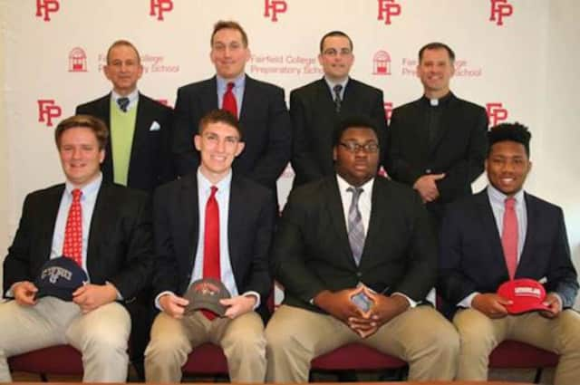 Front row, L-R: Aedan Ayer, Thomas Moore, Samuel Opont-Durogene and Calvin Reed. Second row, L-R: Principal Dr. Robert Perrotta, Coach Keith Hellstern, Asst. Athletic Director Jay Turiano and President Rev. Tom Simisky.