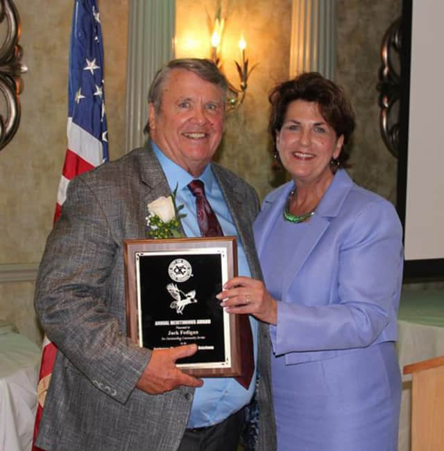 Wappingers Falls Businessman Jack Fedigan was presented the Exchange Club of Southern Dutchess' 50th annual Meritorious Service Award by Club President Denise Doring VanBuren.