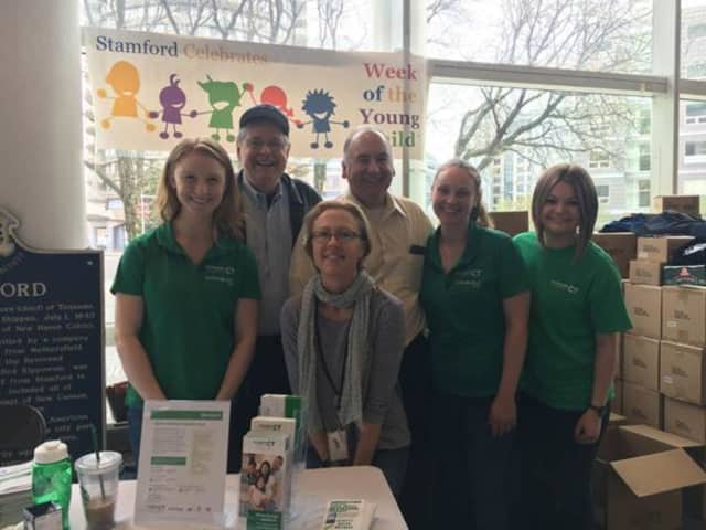 Stamford Mayor David Martin and Associate Planner Erin McKenna with Eversource's Energy Efficiency team.
