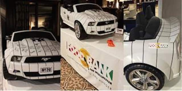 """An autographed New York Yankees' electric """"ride on"""" car is being raffled off on Tuesday, Feb. 28, to raise money for Food Bank for Westchester."""