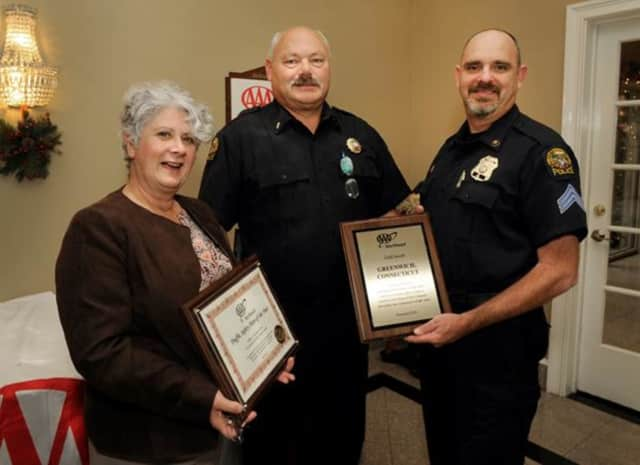 AAA Public Affairs Manager Fran Mayko, left, presents, Lt. John Brown, center, and Sgt. John Slusarz with a Gold Award. Officer Loria could not attend the lunch.