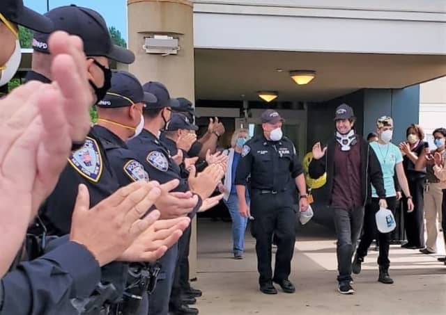 PAPD Officer Peter Siano applauded as he lefts the Kessler Institute for Rehabilitation.