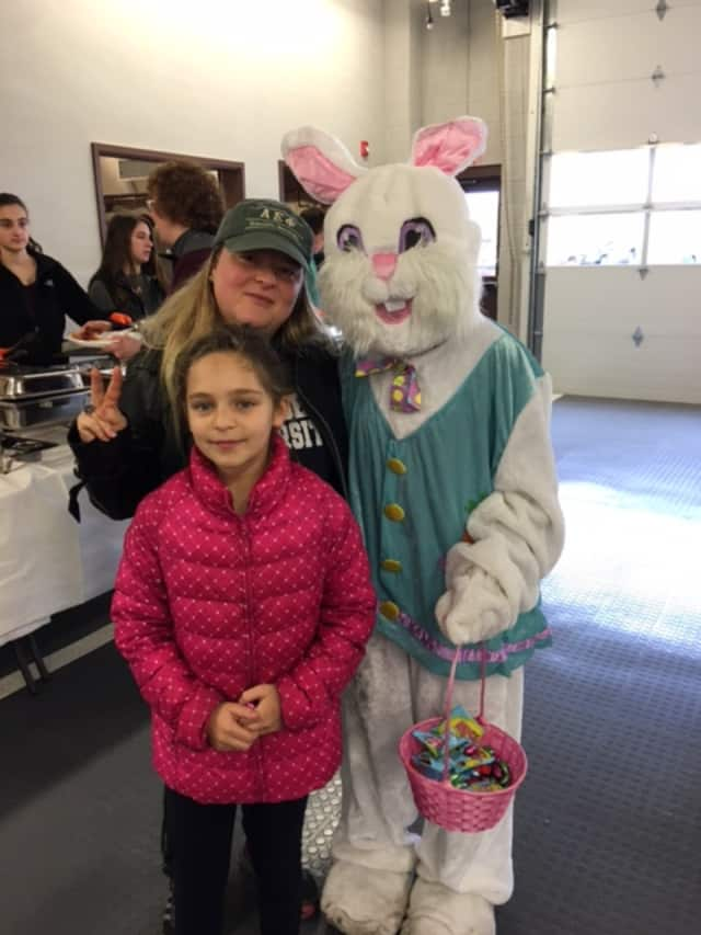 The Easter Bunny with locals at the annual Easter breakfast.