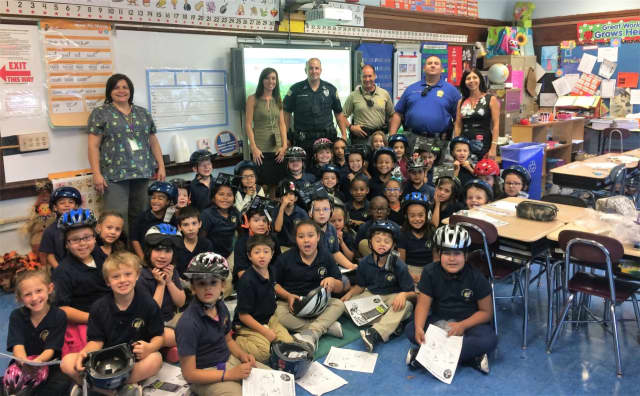 Garfield police officers brought helmets to the youngsters in the second-grade classes of Wioletta Zagorski and Tara Varna.