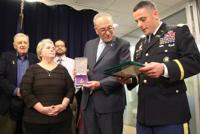 Chuck Schumer presented a Purple Heart to the family of Bernard MacNamara