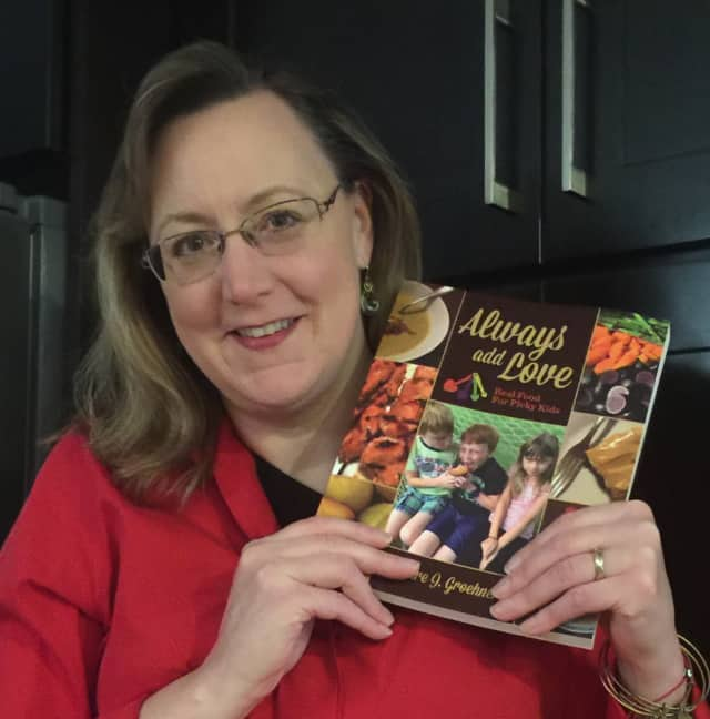 Ridgewood mom and food blogger Deidre Groehnert holds up a copy of her new book, Always Add Love.