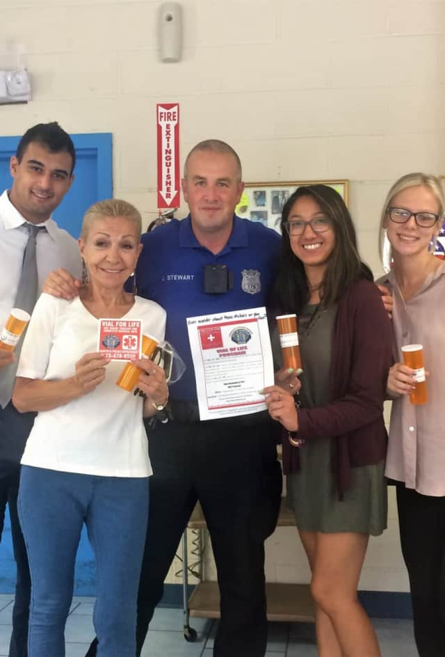 (From left): Danny Seligson of Golden Health Care Pharmacy, resident Nilda Lopez , OfficerJeff Stewart, social workers EJ Nicolas and Jana Devaney.