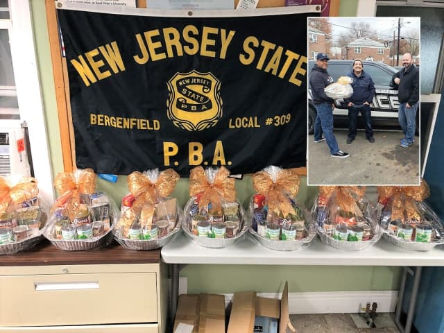 Members of Bergenfield PBA Local 309 assembled and delivered 10 Thanksgiving Day baskets for families in need. INSET (l. to r.): Officers Daynel Ozorio, Andre Enriquez, Tim Knapp.
