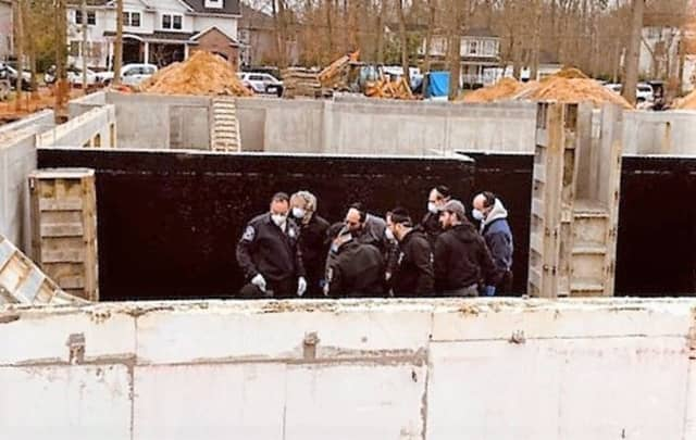 Rescuers at the Lakewood site of the worker's fall.