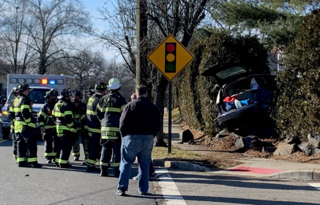 At the scene of the Henley Avenue crash in New Milford.