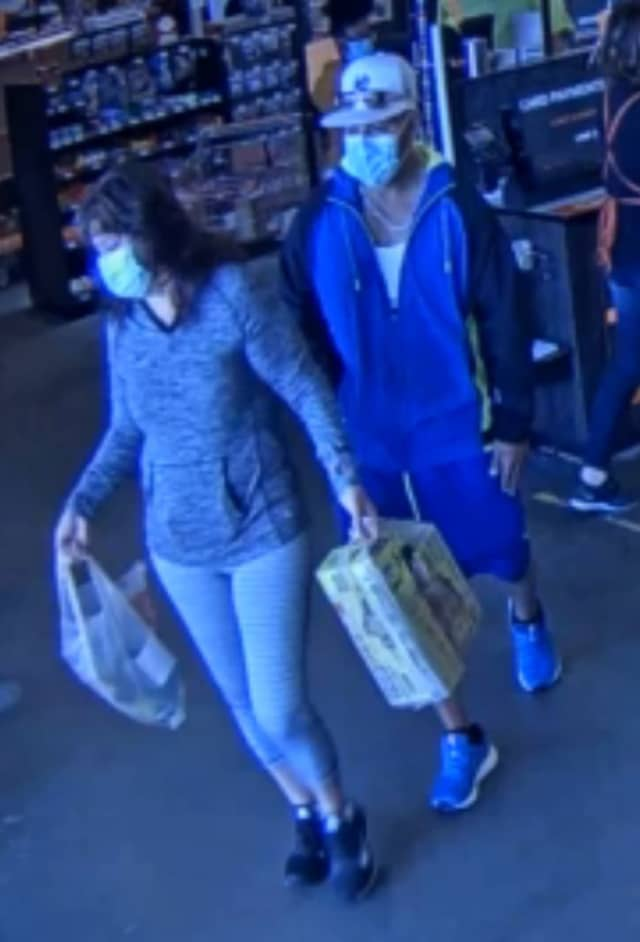 The wanted couple, who spent over $1,000 using someone else's credit card.