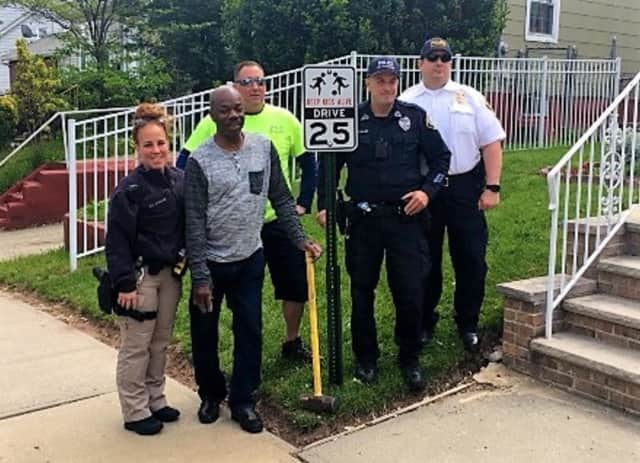 (FROM LEFT:) Garfield Traffic Division Officer Claire Follari, Clyde Bamby, DPW Worker Scott Komstead, Community Affairs Division Officer Jeff Stewart, Capt. Martin Gray.