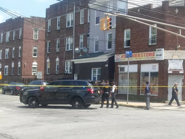 Irvington police and Essex County Sheriff's officers at the scene of a shooting Aug. 8 that left three police officers wounded and two killed, including the gunman.