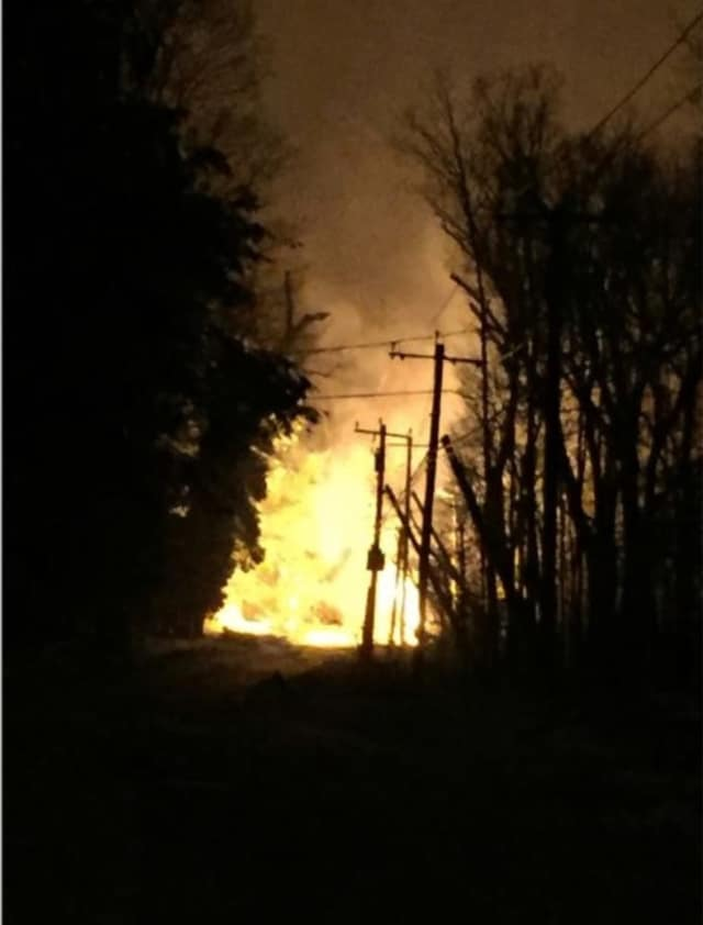 Downed power lines caught fire in New Canaan on Wednesday night.