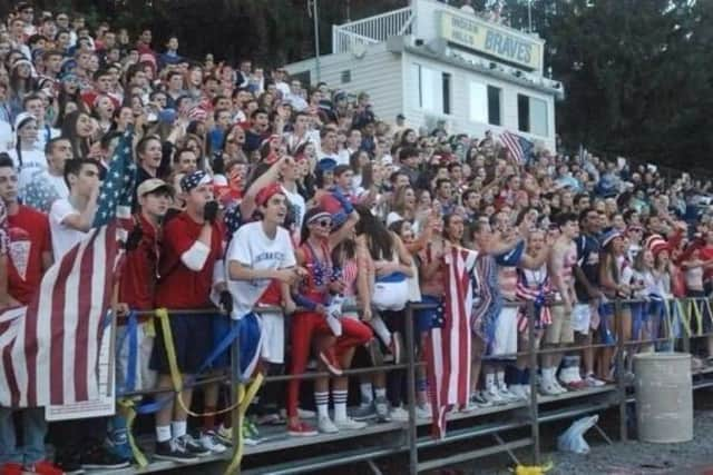 Fans cheer at a New Jersey high school football game last year.