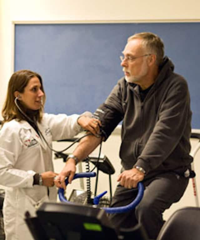 A patient works out while his blood pressure is taken at Danbury Hospital's Marcus Cardiac Rehabilitation Center.