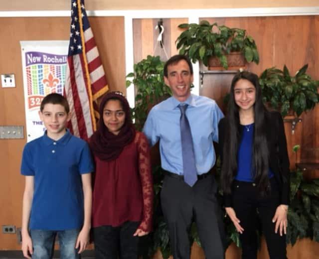 The class presidents are shown, from left, 8th grade President Adolfo Mejia, 6th grade President Mariyam Mubarak, Mayor Noam Bramson and 7th grade President Alejandra Ceja.