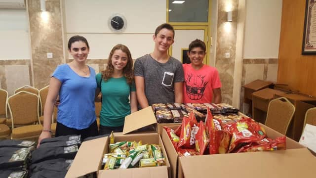 The Firsch School students are shown with care packages they sent to soldiers in Israel.