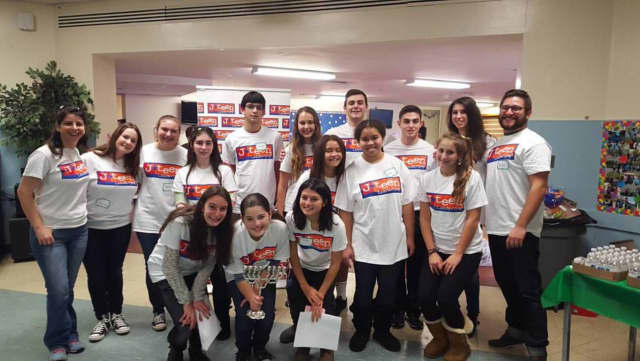J-Teen participants are shown at a holiday party in December.