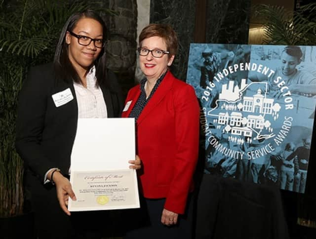 Kevona Jackson, left, a business student at the College of New Rochelle, is the recipient of a service award and a scholarship. With Jackson is Dr. Danielle Wozniack, dean of the college's School of Arts and Sciences.