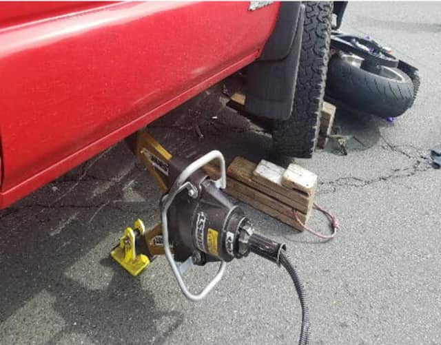 Danbury firefighters used a new TL-9 device to lift a pickup truck off a motorcyclist who was pinned after a crash.