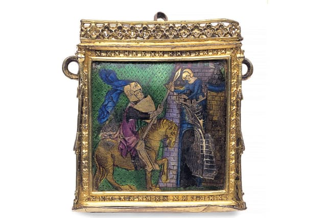 """Case for a small book or relic (height 5.6 cm/2.2 in). The enameled scene shows a knight giving his spear to a lady leaning from castle battlements, probably a scene from the """"Romance of Sir Enyas and the Wodewose (wild man)."""" England or France, mid-1300s. © Victoria and Albert Museum, London. Courtesy Thames & Hudson."""
