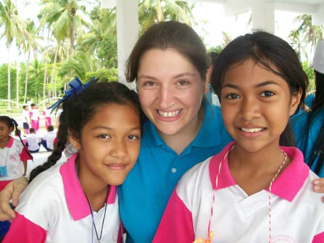 Jen Silverman of Ringwood, center, with girls shed worked with at an English camp in Thailand.