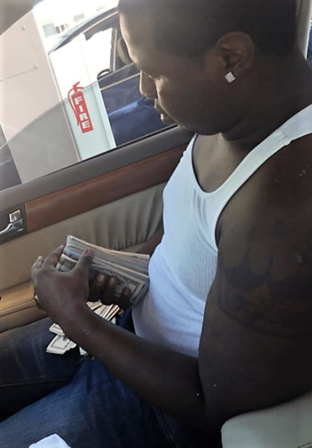 "Roney flaunted his wealth on Instagram as ""jayshmoney,"" posting photos of himself holding fat stacks of cash, traveling internationally and driving luxury cars."