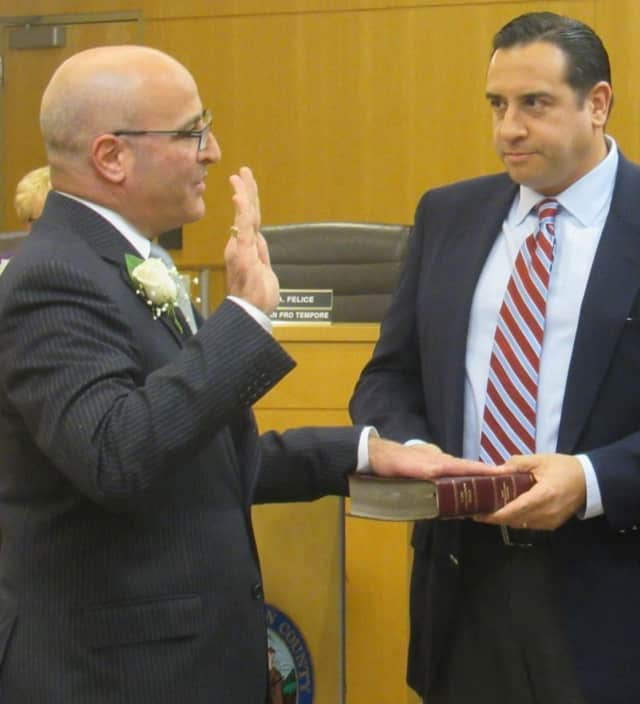 John Felice being sworn to office.