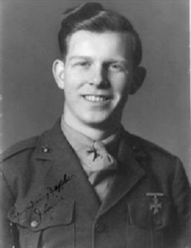 Marine Pfc. James B. Johnson was only 19 years old when he was killed in a fierce battle in the Pacific during World War II. He was buried with full military honors in Arlington National Cemetery Tuesday.