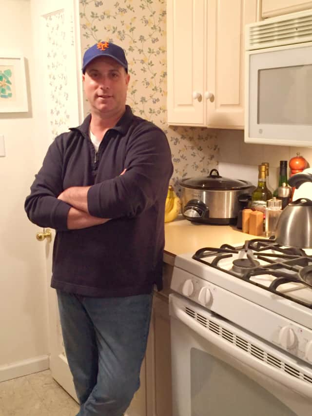 Jon Neschis in his Norwalk, Conn. kitchen.
