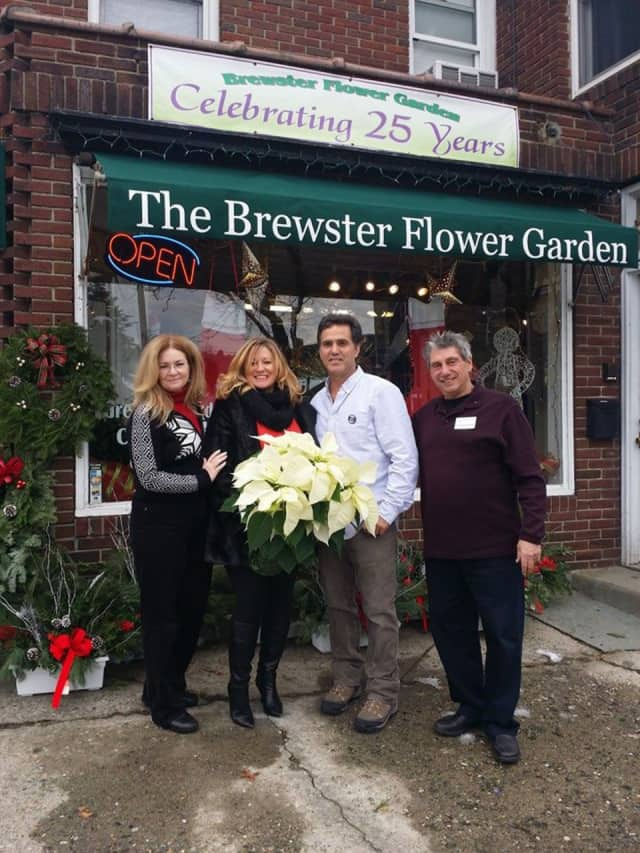 From left, Putnam County Executive MaryEllen Odell business owners Jenn Maher, of J. Philip Commercial Group and the Putnam Chamber of Commerce; Mark Buzzetto, The Brewster Flower Garden; and Geoffrey Reinwald, Brewster Chamber of Commerce.