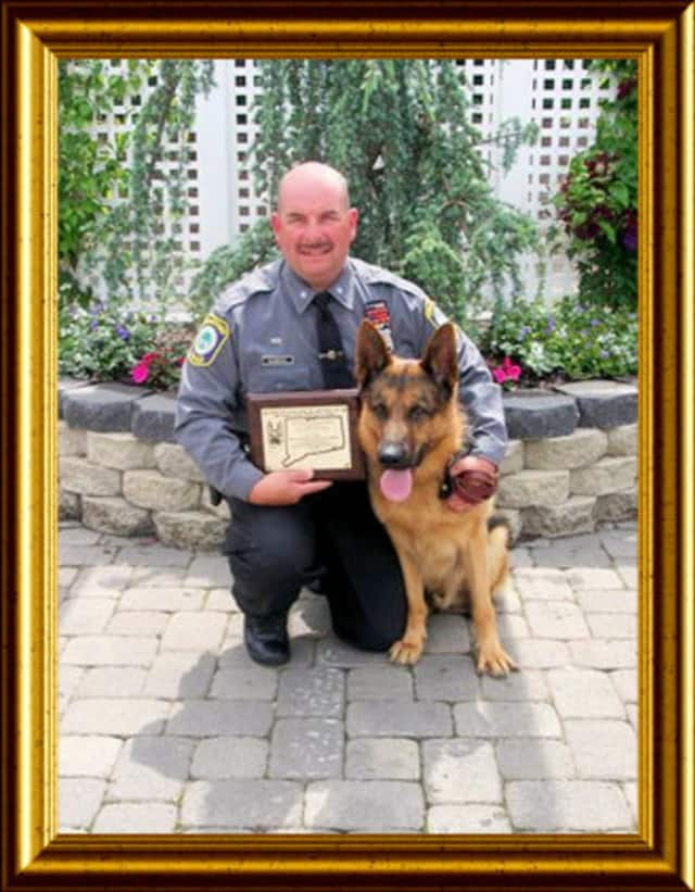Stratford Police Officer Thomas Clements and his K-9 partner Kahn retired last week. He is pictured here with his first dog, Zak, who died on duty in 2009.