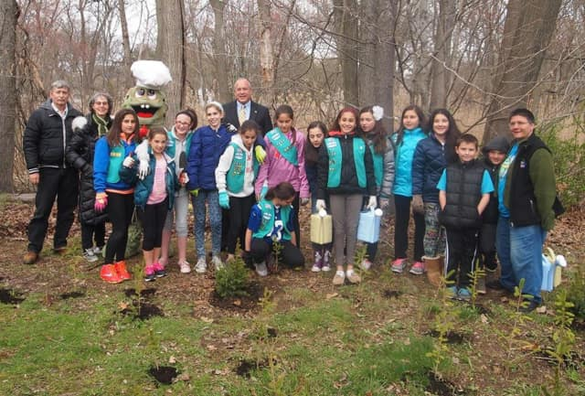 Arborist Michael Marks from Almstead celebrated Arbor Day in 2015 by planting trees and doing compost applications, along with local Girl Scouts, at the Magic Treetures Forest Nursery in Eastchester. The 2016 celebration is April 29.