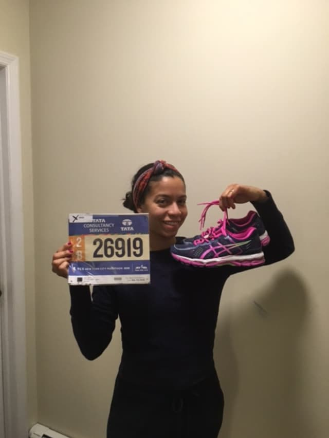 Yonkers resident Karen Rivera-Filippi shows off her number for her seventh New York City Marathon.