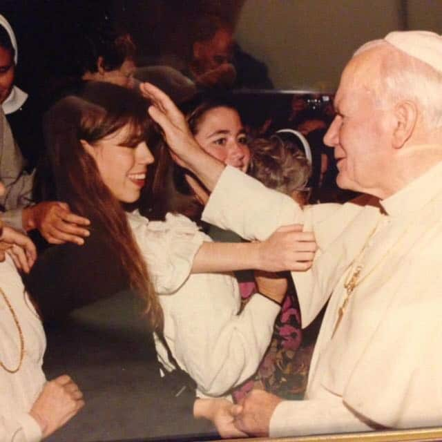 Katherine Tucker at Pope John Paul II. He is holding her hand while bestowing a blessing.
