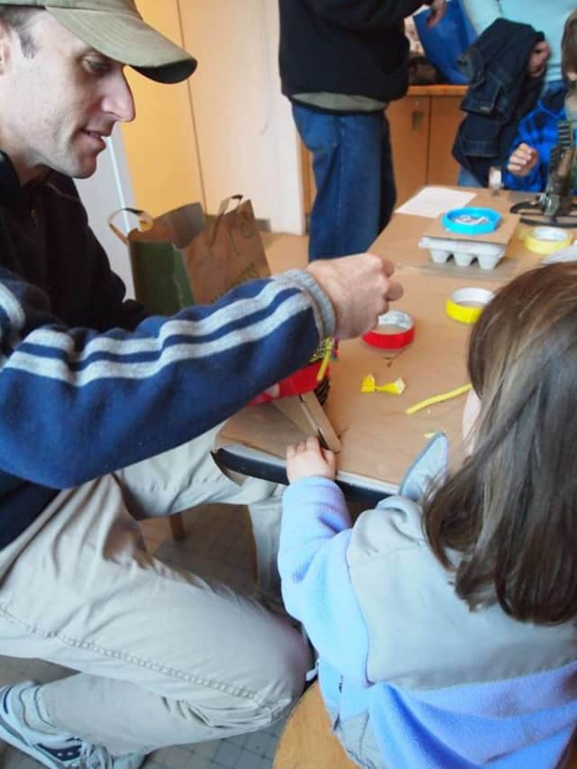 Get a museum pass at the New Rochelle Library and visit to participating museums free or discounted. Here, visitors enjoy Family Day at the Katonah Museum of Art.