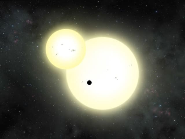 Artist's impression of the simultaneous stellar eclipse and planetary transit events on Kepler-1647.