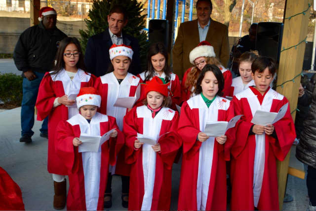 The St. Peter and Paul Children's choir entertained the crowd at the annual tree lighting in Mount Vernon.